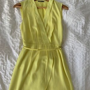 Bright neon yellow knee length belted wrap dress